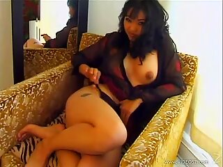 Seductive Mika Tan loves teasing her juicy moist pussy
