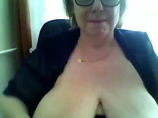 busty babe is on the webcam doing her stuff