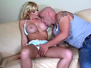 Oiled up blonde darling with big boobies is here to show off