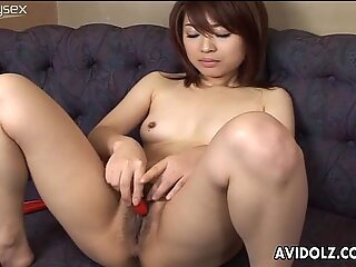 Lustful Japanese chick AI Nonohara masturbates on a couch using small vibrator