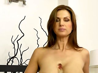Horny inked up MILF masturbates in front of a cam