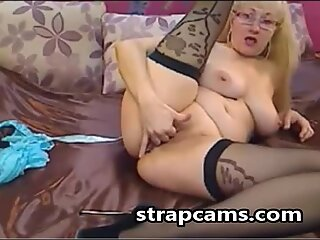 Blonde granny undressing and fingers pussy for us