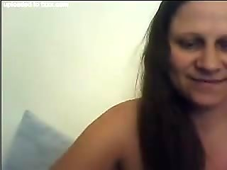Dirty-minded long haired ugly as fuck brunette webcam MILF posed topless