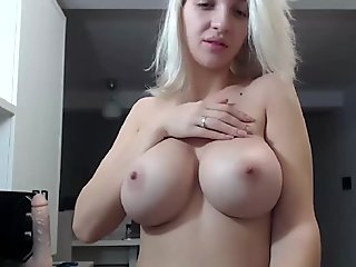 Big Tits Blonde Blowing Dildo On Cam
