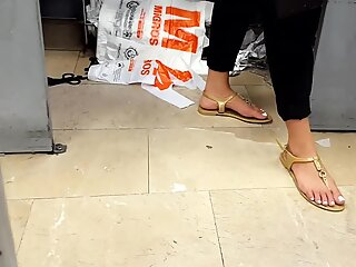 Her sexy big long feets toes in sandals